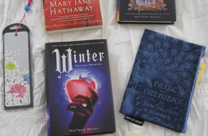 Showing off the awesome goodies I got in the Books 'n' Bloggers Swap!