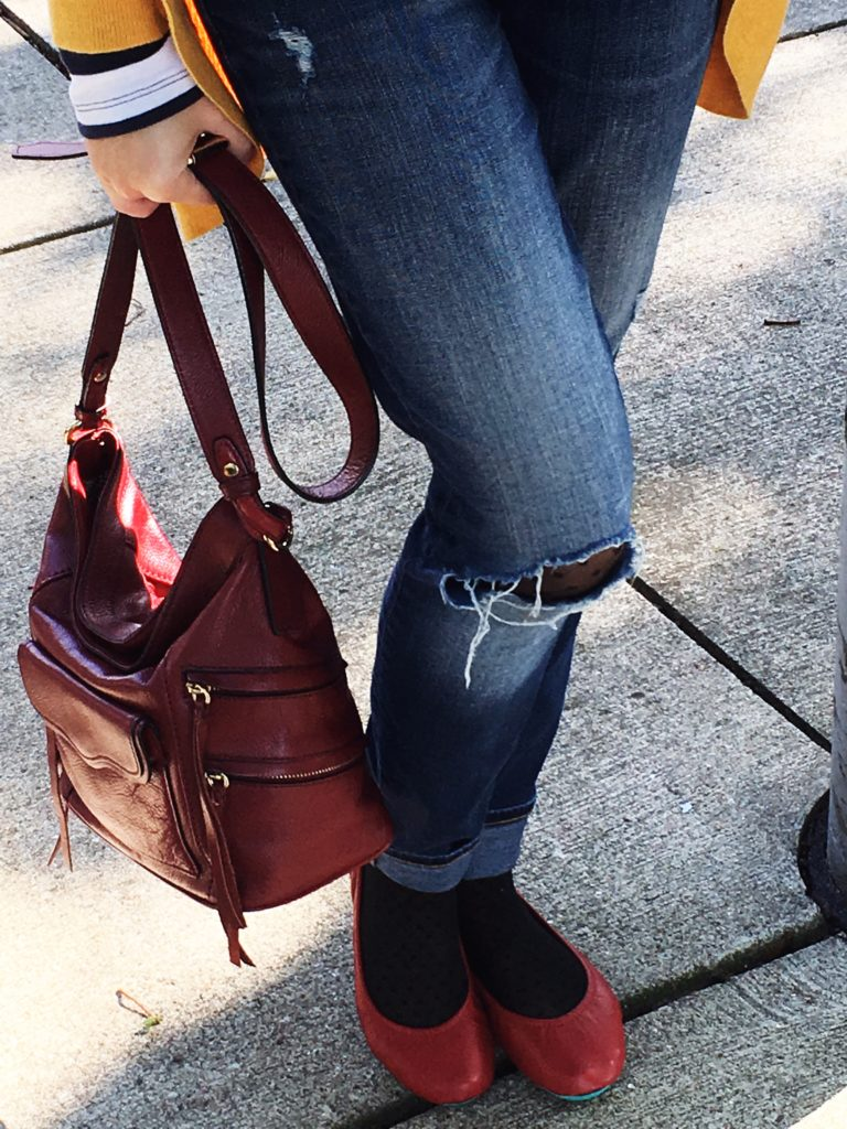 Don't let fall's chilly days keep you from wearing your distressed jeans. Wearing cute tights under jeans will keep you warm and stylish.