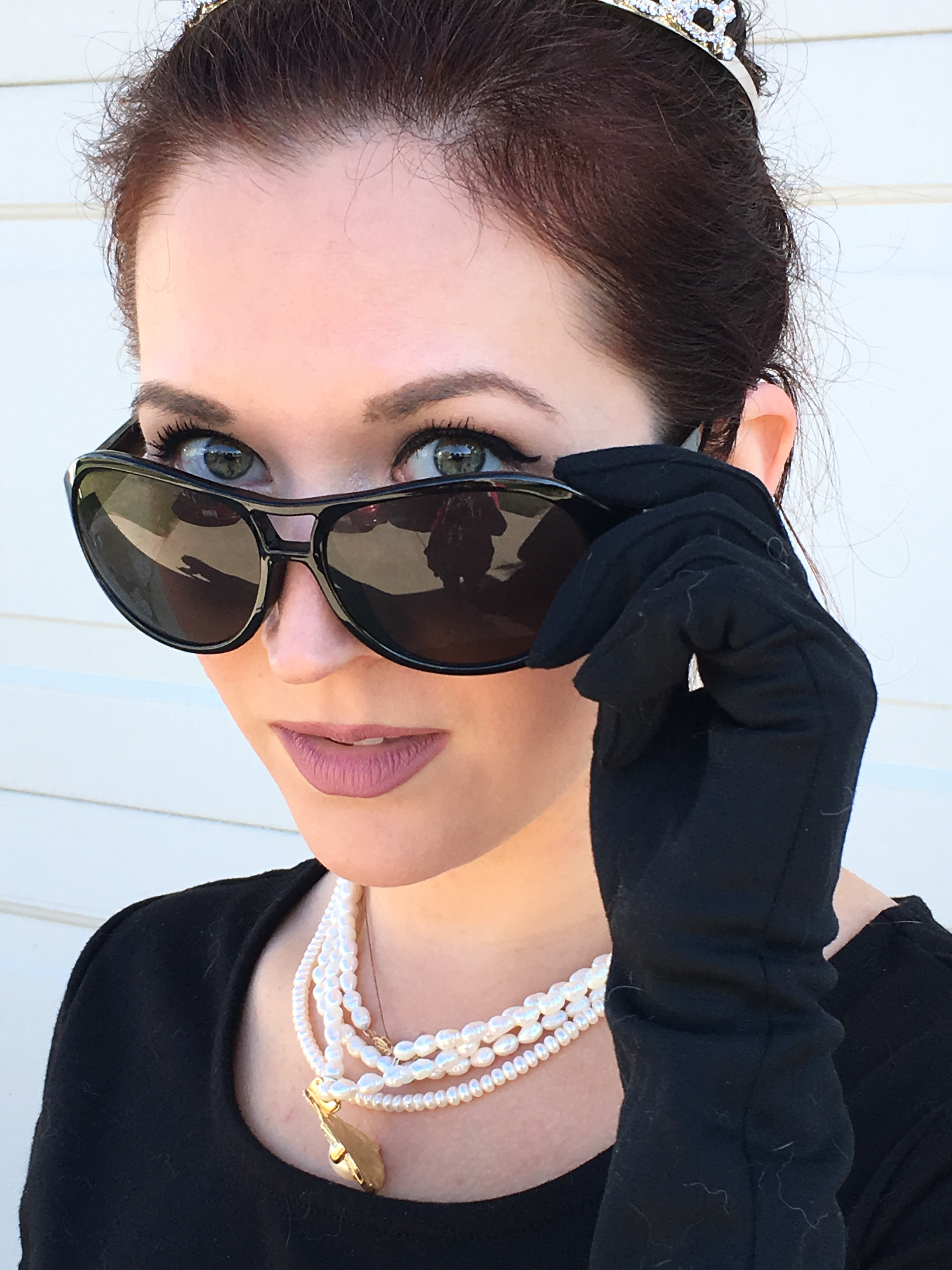 Steal Audrey Hepburn's style in Breakfast at Tiffany's with this last minute Halloween costume. Grab a black dress, gloves, pearls, and tiara for the look.